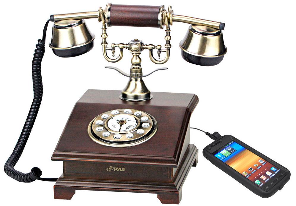 ▲ 老式电话机与现代手机