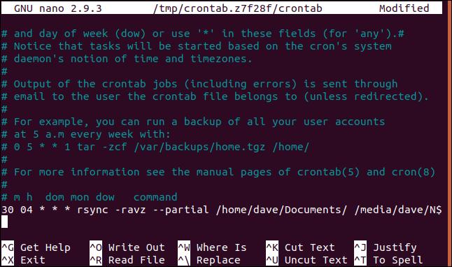 crontab open in nano in a terminal window