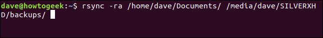 rsync -ra /home/dave/Documents/ /media/dave/SILVERXHD/backups/ in a terminal window