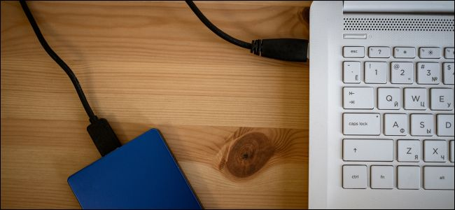 External hard drive plugged into laptop via USB