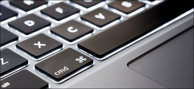 A MacBook user using keyboard shortcuts to copy and paste text on Mac