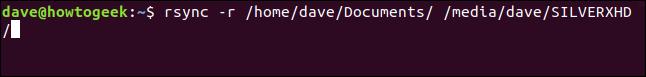 rsync -r /home/dave/Documents/ /media/dave/SILVERXHD/ in a terminal window